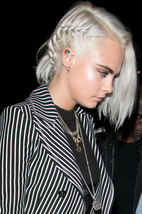 Cara Delevingne with ice blonde hair.